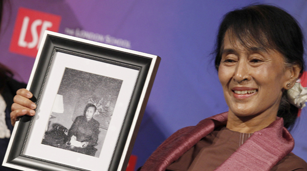 Myanmar pro-democracy leader Aung San Suu Kyi holds a photograph of her father, which was presented to her following a discussion at the London School of Economics in central London