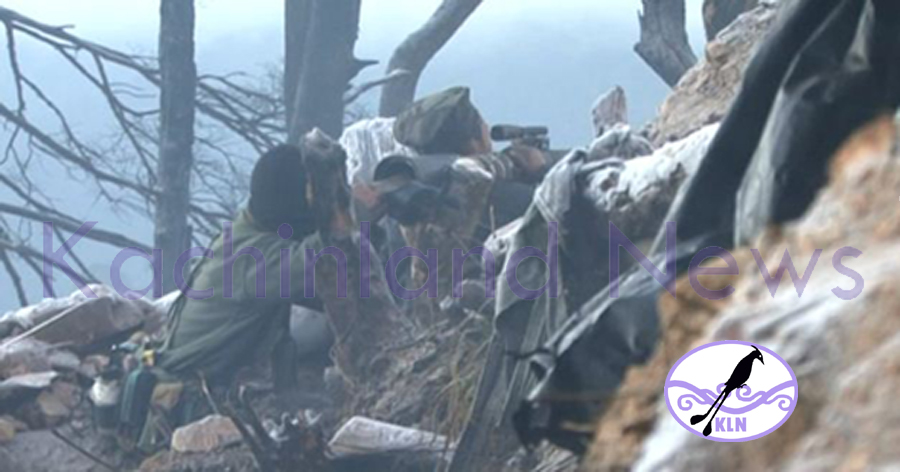 Kachin soldiers in front-line watching over the valley