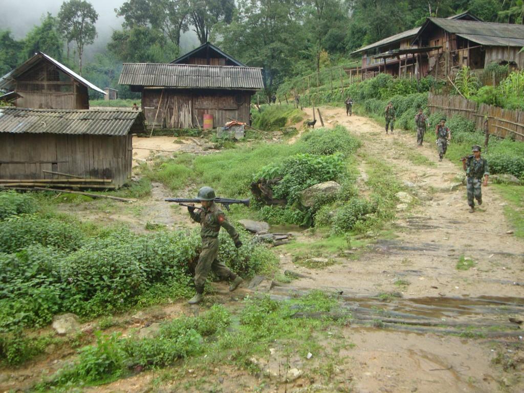 KIA troops passing through a village (Photo: Namhkai Hka)
